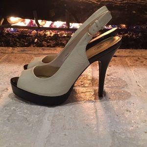 Beige and black sling back heels
